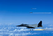 F-15 Eagle aircraft fire AIM-7 Sparrow missiles.