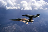 DBR100004M © Stocktrek Images, Inc. An F-5 Tiger II and F-4 Phantom II during a tactics development flight.