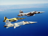 DBR100009M © Stocktrek Images, Inc. Three F-5E Tiger II fighter aircraft in flight.