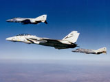 DBR100011M © Stocktrek Images, Inc. An F-14 Tomcat and two F-4 Phantom II's during a training flight.