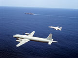 DBR100023M © Stocktrek Images, Inc. An F-14 Tomcat fighter escorts a Soviet Il-38 patrol aricraft over the Indian Ocean.
