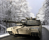 STK101271M © Stocktrek Images, Inc. A M-1A Abrams tank drives through the Tuanus Mountains.