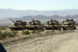 STK101882M © Stocktrek Images, Inc. Marines gather around their respective tanks at the firing line.