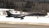 STK102329M © Stocktrek Images, Inc. A B-1B Lancer performs a touch and go before landing.