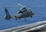 STK102347M © Stocktrek Images, Inc. A French Dolphin 35F helicopter takes off from the flight deck of USS John C. Stennis.
