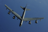 STK103777M © Stocktrek Images, Inc. A U.S. Air Force B-52 Stratofortress flies a mission over the Pacific Ocean.