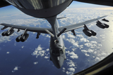 STK103778M © Stocktrek Images, Inc. A KC-135 Stratotanker aircraft refuels a B-52 Stratofortress aircraft over the Pacific Ocean.