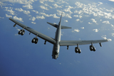 STK103779M © Stocktrek Images, Inc. A U.S. Air Force B-52 Stratofortress flies a mission over the Pacific Ocean.
