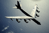 STK103780M © Stocktrek Images, Inc. A B-52 Stratofortress in flight over the Pacific Ocean.