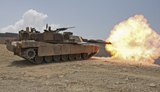 STK104415M © Stocktrek Images, Inc. Marines bombard through a live fire range using M1A1 Abrams tanks.