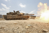 STK104416M © Stocktrek Images, Inc. Marines bombard through a live fire range using M1A1 Abrams tanks.