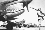 STK106032M © Stocktrek Images, Inc. A Chinese soldier guards a line of American P-40 fighter planes during WWII.