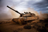 STK106239M © Stocktrek Images, Inc. Marines roll down a dirt road on their M1A1 Abrams Main Battle Tank.