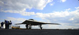 STK107573M © Stocktrek Images, Inc. An X-47B Unmanned Combat Air System on the flight deck of  USS George H.W. Bush.