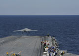 STK107575M © Stocktrek Images, Inc. An X-47B Unmanned Combat Air System launches from USS George H.W. Bush.