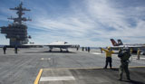 STK107578M © Stocktrek Images, Inc. An X-47B Unmanned Combat Air System aboard USS George H.W. Bush.