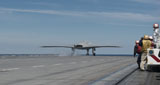 STK107580M © Stocktrek Images, Inc. An X-47B Unmanned Combat Air System launches from USS George H.W. Bush.