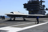STK107582M © Stocktrek Images, Inc. An X-47B Unmanned Combat Air System aboard USS George H.W. Bush.