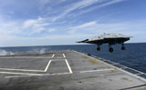STK107586M © Stocktrek Images, Inc. An X-47B Unmanned Combat Air System launches from USS George H.W. Bush.