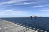 STK107587M © Stocktrek Images, Inc. An X-47B Unmanned Combat Air System launches from USS George H.W. Bush.
