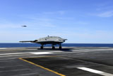 STK107596M © Stocktrek Images, Inc. An X-47B unmanned combat air system conducts a touch and go landing.