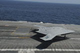 STK107694M © Stocktrek Images, Inc. An X-47B Unmanned Combat Air System makes an arrested landing.