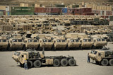 STK108047M © Stocktrek Images, Inc. Rows of heavy vehicles and supplies at Camp Warrior, Afghanistan.