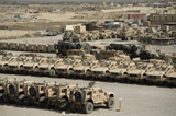 STK108048M © Stocktrek Images, Inc. Rows of heavy vehicles and supplies at Camp Warrior, Afghanistan.
