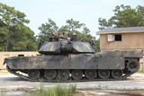 STK108417M © Stocktrek Images, Inc. An M1A1 Abrams tank takes a defensive position on a simulated enemy town.