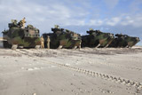 STK108476M © Stocktrek Images, Inc. U.S. Marines inspect AAV-P7/A1 amphibious assault vehicles.