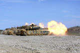 STK108602M © Stocktrek Images, Inc. M1A1 Abrams fire their 120mm smoothbore cannon.