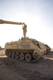 TMO100050M © Stocktrek Images, Inc. A US Army mechanic uses a M113 as a platform to boresight a M1 Abrams tank.