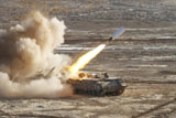 ZDN100111M © Stocktrek Images, Inc. An Israel Defense Force Puma M26 launches a mine clearing line charge.