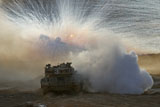 ZDN100112M © Stocktrek Images, Inc. An Israel Defense Force Merkava Mark II main battle tank in a live fire exercise.