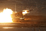 ZDN100113M © Stocktrek Images, Inc. An Israel Defense Force Artillery Core MLRS launches a rocket.
