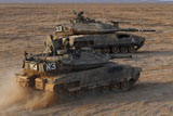 ZDN100114M © Stocktrek Images, Inc. A pair of Israel Defense Force Merkava Mark IV main battle tanks.
