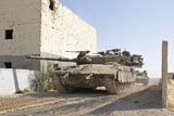 ZDN100137M © Stocktrek Images, Inc. An Israel Defense Force Merkava Mark II main battle tank in urban warfare.