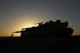 ZDN100145M © Stocktrek Images, Inc. An Israel Defense Force Merkava Mark IV main battle tank at sunset.