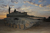 ZDN100146M © Stocktrek Images, Inc. A morning prayer on an Israel Defense Force Merkava Mark IV battle tank.
