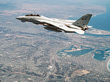 DBR100028M © Stocktrek Images, Inc. An F-14A Tomcat cruises above San Diego, California.
