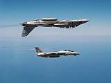 DBR100029M © Stocktrek Images, Inc. Two F-14A Tomcats perform aerobatics above the Pacific Ocean.