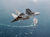 DBR100030M © Stocktrek Images, Inc. An F-14A Tomcat eturns to USS Nimitz after Operation Southern Watch.