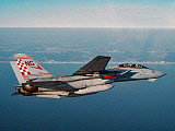 DBR100031M © Stocktrek Images, Inc. An F-14A Tomcat cruises near Virginia Beach during a morning training mission.