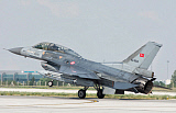 GCA100660M © Stocktrek Images, Inc. Turkish Air Force F-16 lands on runway in Konya, Turkey.