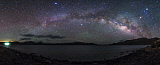 JFD200039S © Stocktrek Images, Inc. The rising arc of the Milky Way above Yamdrok Lake, Tibet, China.