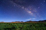 JFD200040S © Stocktrek Images, Inc. The Milky Way over a field of hulless barley in Tibet, China.