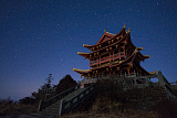 JFD200049S © Stocktrek Images, Inc. Stars of the Big Dipper and constellation Leo shine above a temple of Mount Emei in China.