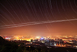 JFD200050S © Stocktrek Images, Inc. Stars appear above city lights of Chongqing city, China.