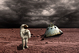 MRC200136S © Stocktrek Images, Inc. An astronaut surveys his situation after being marooned on a barren planet.