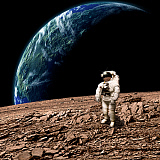 MRC200138S © Stocktrek Images, Inc. An astronaut on a barren planet with Earth-like planet in background.